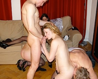 Four mature women and one strapping young lad